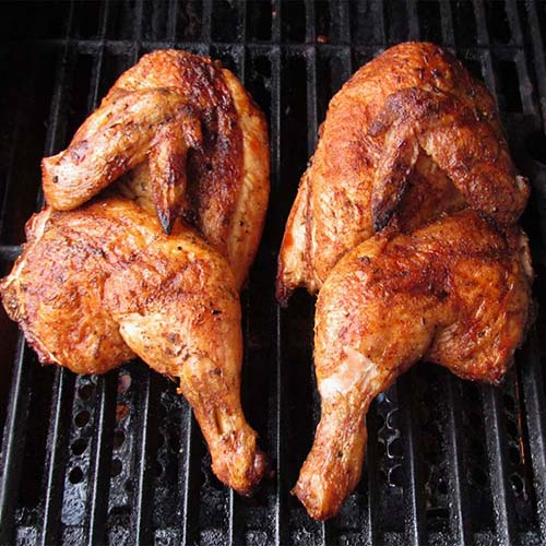 Half Chickens on Grill