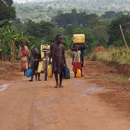Children of Kirinda hauling water